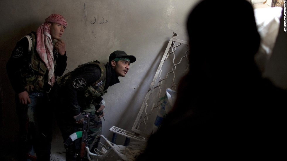 Syrian rebels take position in Aleppo, the largest city in the country, on March 11.