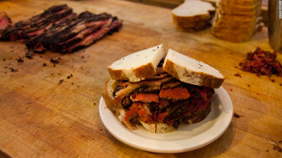 Introduced at Jewish delis in Montreal, smoked meat draws comparisons to pastrami. From a different cut of beef, Montreal smoked meat is spiced differently. Pictured: Montreal smoked meat from Mile End Delicatessen in Brooklyn.