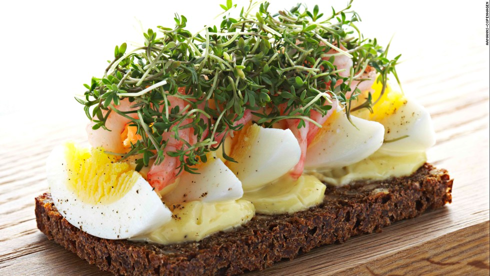 A traditional open-faced sandwich from Denmark, smørrebrød is made with a butter base on dark rye bread. Toppings might include smoked salmon or roast beef with arugula and horseradish crème fraiche. Pictured: eggs with freshly peeled shrimp smørrebrød from Aamanns-Copenhagen in New York.