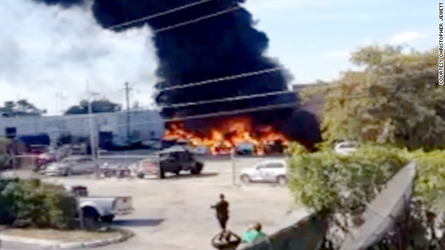 Smoke billows from the site of a plane crash near Ft. Lauderdale Executive Airport.