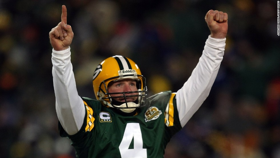Quarterback Brett Favre of the Green Bay Packers reacts after a Packers touchdown during a championship game against the New York Giants in January 2008, in Green Bay, Wisconsin. That same year he announced his retirement but changed his mind two more times before finally retiring in 2011.