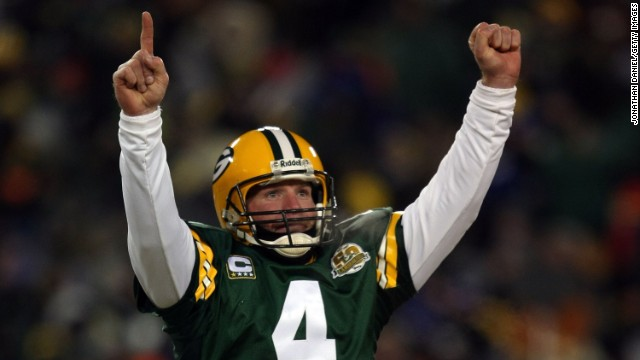 GREEN BAY, WI - JANUARY 20:  Quarterback Brett Favre #4 of the Green Bay Packers reacts after a Packers touchdown during the NFC championship game against the New York Giants on January 20, 2008 at Lambeau Field in Green Bay, Wisconsin. The Giants defeated the Packers 23-20 in overtime to advance to the Superbowl XLII.  (Photo by Jonathan Daniel/Getty Images)