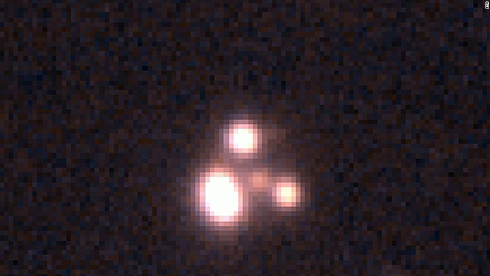 An image of a quasar is seen through a telescope.