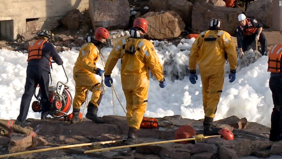 Authorities from various agencies converged on the scene, their task of finding the two people complicated by zero visibility in the cold, fast-moving, debris-filled waters.