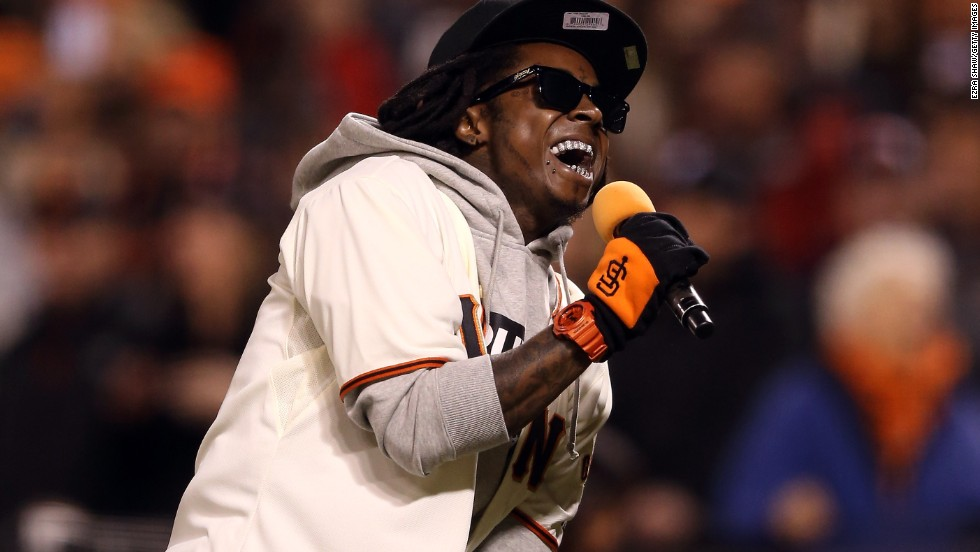 "Lil Wayne sings ""Take Me Out to the Ball Game"" during the seventh-inning stretch as the San Francisco Giants took on the St. Louis Cardinals during the National League Championship Series in 2012."