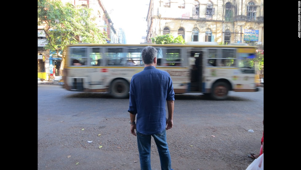 Bourdain stands on the streets of Yangon.