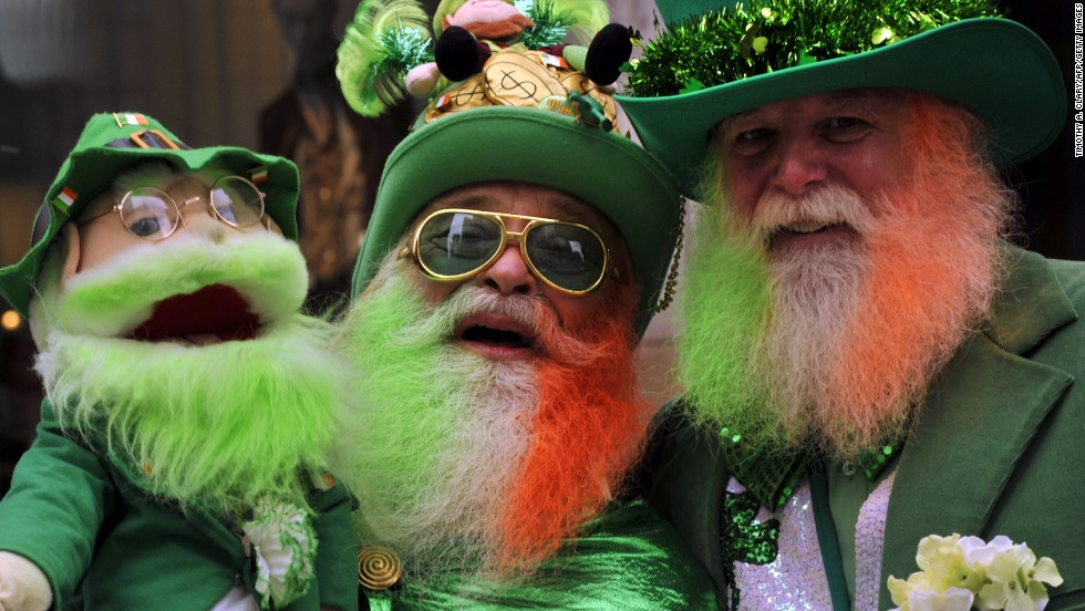 Two revelers and their puppet companion party during the 252nd New York City St. Patrick's Day Parade on Saturday, March 16.
