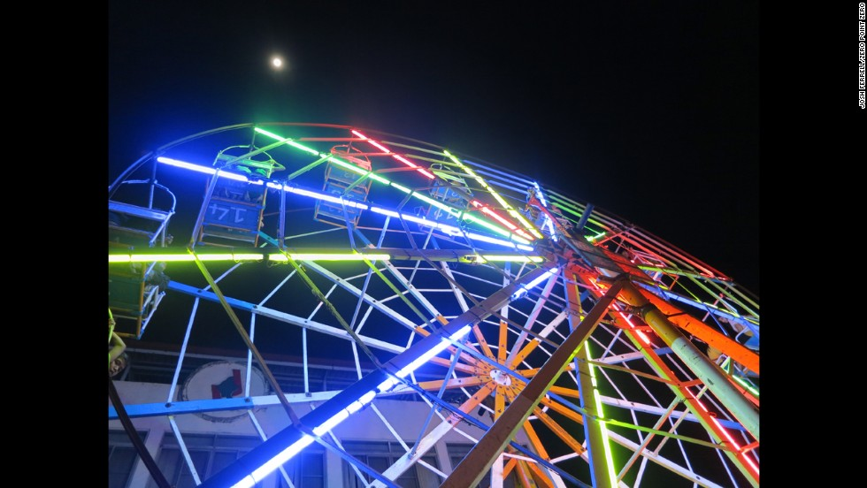 "At a festival in Myanmar, Bourdain spots a unique carnival ride: a Ferris wheel driven by human power. He describes it as an ""insanely dangerous, closely choreographed process of first getting the giant, heavily laden wheel in motion and then getting it up to top speed and keeping it there."""