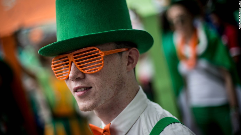 A man dressed in costume waits for the parade to start during the Singapore St. Patrick's Day street festival on March 17.