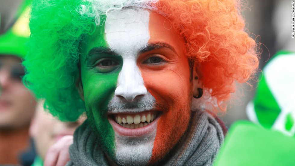 A reveler with his face painted the colors of the Irish flag attends St. Patrick's Day festivities in Dublin on March 17.