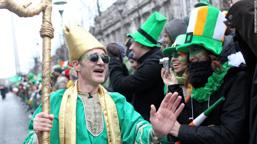A man dressed as St. Patrick walks along the parade route during festivities in Dublin on March 17.