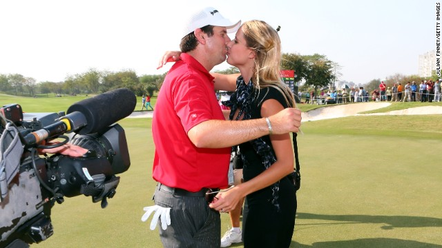 Thomas Aiken of South Africa celebrates with wife Kate after winning the Avantha Masters in India.