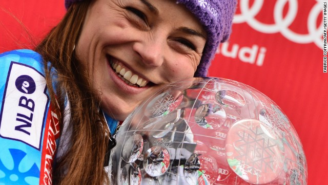 Tina Maze clutches her crystal globe after winning the giant slalom in the final race of the World Cup season.