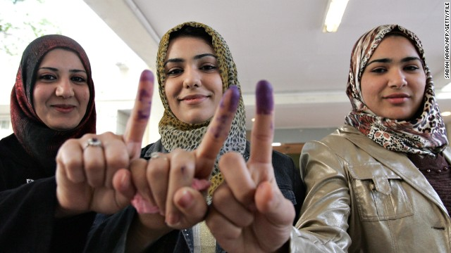 Iraqi women show off their ink stained fingers after voting in the provincial elections in central Baghdad on 31 January 2009.