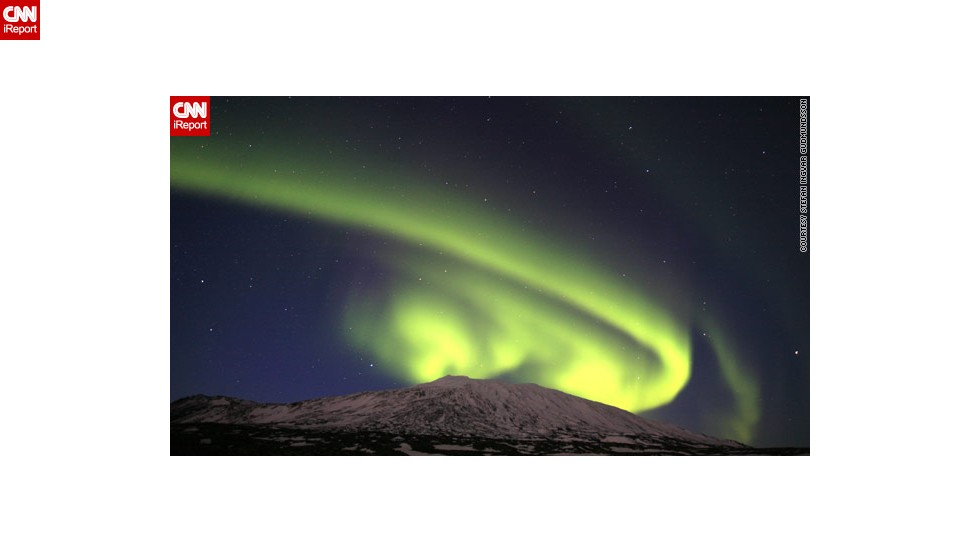 "A spectacular solar event over the weekend provided a stunning showing of the northern lights, or aurora borealis. This image by Stefan Ingvar Gudmundsson from Iceland captures the lights <a href=""http://ireport.cnn.com/docs/DOC-943369"">appearing to curl</a> around the Snaefellsjokull glacier."