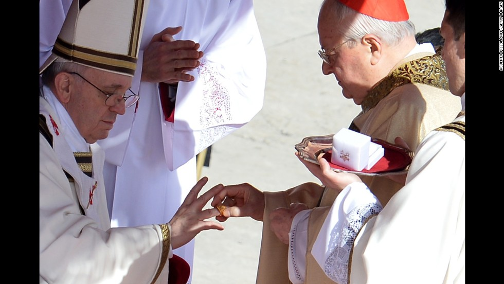 Italian cardinal Angelo Sodano puts the fisherman's ring on Pope Francis' finger during the inauguration Mass. The ring represents the pope's role in spreading the Gospel.