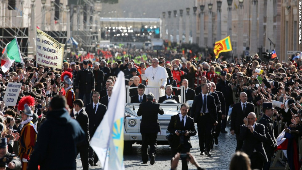 Pope Francis rides through the throngs of faithful in St. Peter's Square. He circled the square in an open-top vehicle, bypassing the Popemobile with its bulletproof glass.