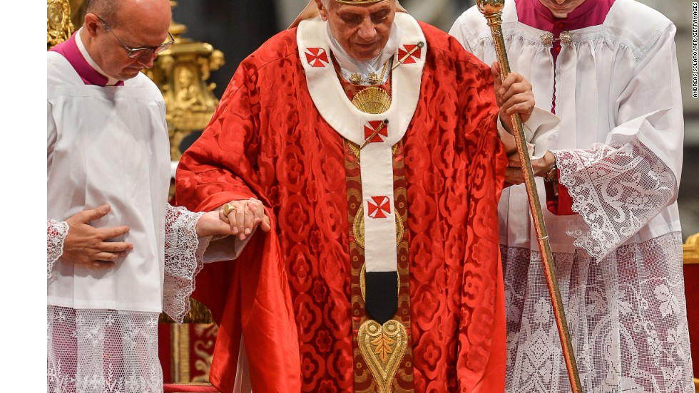 "Pope Benedict XVI is seen here wearing the pallium, a woolen cloak with five or six crosses. It's worn only by the pope and archbishops as a sign of their unity to the pope, Beck said. ""It is made from the wool of lambs raised by monks and woven by nuns. It is rich in symbolism, as the pope, who is shepherd, literally carries the 'sheep' on his shoulders, especially the lost ones,"" Beck said."