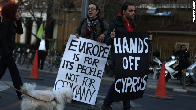 Cypriots protest against an EU bailout deal outside the parliament in Nicosia on March 19, 2013.