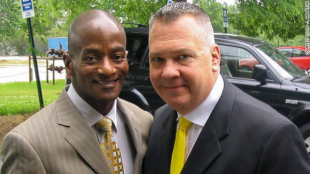 Scott J. Hamilton, right, and his husband, Wayne C. Johnson.