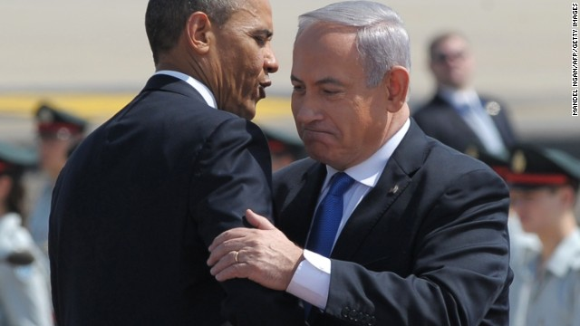 US President Barack Obama (L) hugs Israel's Prime Minister Benjamin Netanyahu (R) during a welcome ceremony at Ben Gurion International Airport on March 20, 2013 near Tel Aviv. Obama landed in Israel for the first time as US president, on a mission to ease past tensions with his hosts and hoping to paper over differences on handling Iran's nuclear threat. AFP PHOTO/MANDEL NGAN (Photo credit should read MANDEL NGAN/AFP/Getty Images)