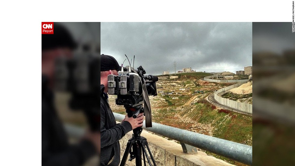 CNN photojournalist Chris Turner shoots video of the Israeli West Bank barrier wall from the Israeli side.  Tensions are increasing on both sides of the wall, including rock attacks on settlers on roads that run between Israeli and Palestinian neighborhoods.