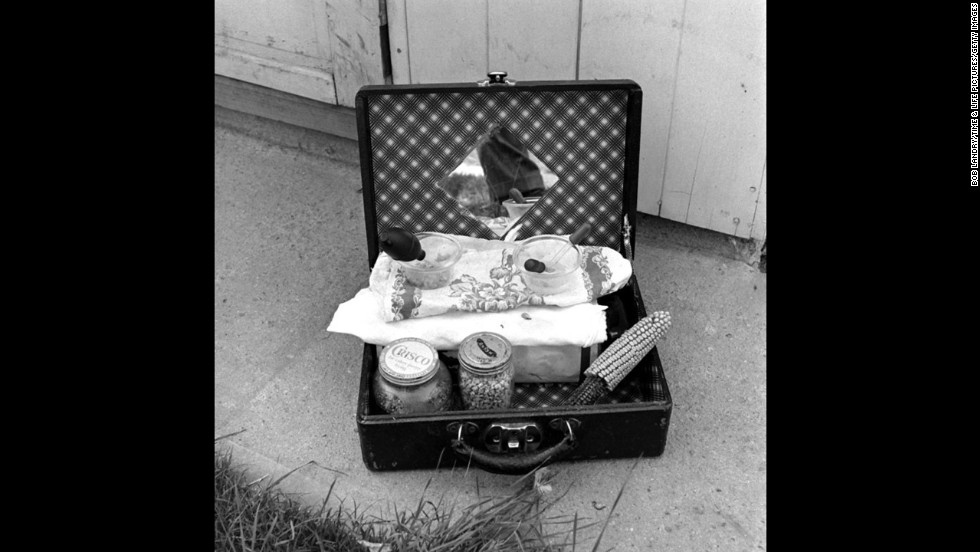 A suitcase holds the tools for feeding Mike, including an eye dropper that was used to provide sustenance through the hole where his head used to be.