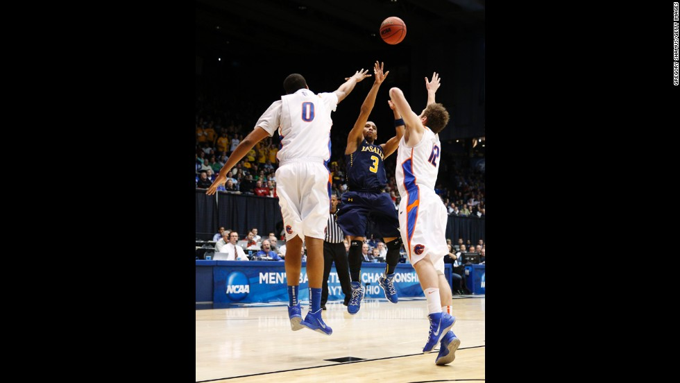 Tyreek Duren of the La Salle Explorers takes a shot as Ryan Watkins, left, and Igor Hadziomerovic, right, of the Boise State Broncos defend on March 20.