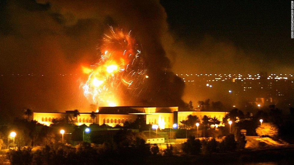 Smoke covers the presidential palace compound during a massive US-led air strike in Baghdad, March 21, 2003. The resolution to go to war with Iraq was passed by the House, 296-133, and the Senate, 77-23.