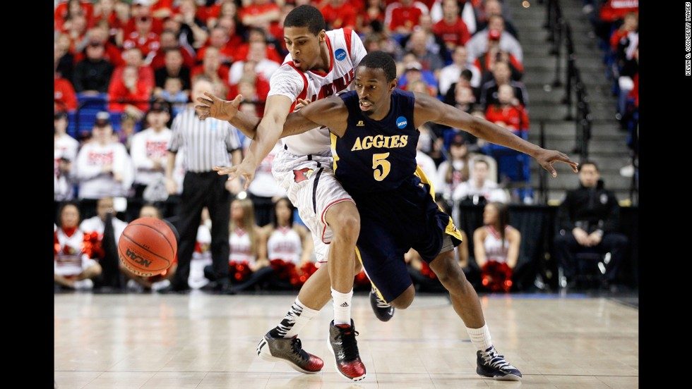 Wayne Blackshear of Louisville steals the ball from Jean Louisme of the N.C. A&T on March 21.
