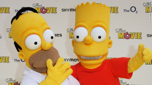 Characters Homer (L) and Bart Simpson (R) arrive at the Simpsons movie premiere in London, England on July 25, 2007.