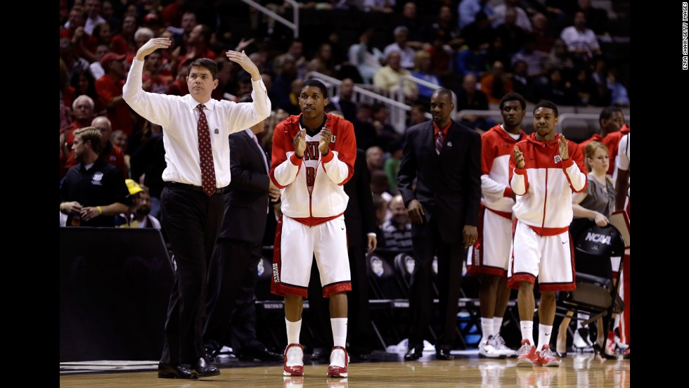 Head coach Dave Rice of the UNLV Rebels and his players react after a play against the California Golden Bears on March 21.