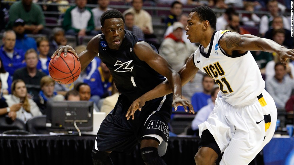 Demetrius Treadwell of the Akron Zips drives against Treveon Graham of the Virginia Commonwealth University Rams on March 21 in Auburn Hills, Michigan.