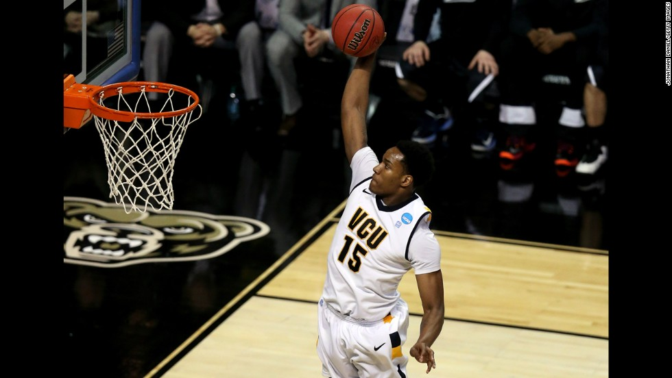 Juvonte Reddic of VCU dunks in the first half against Akron on March 21.
