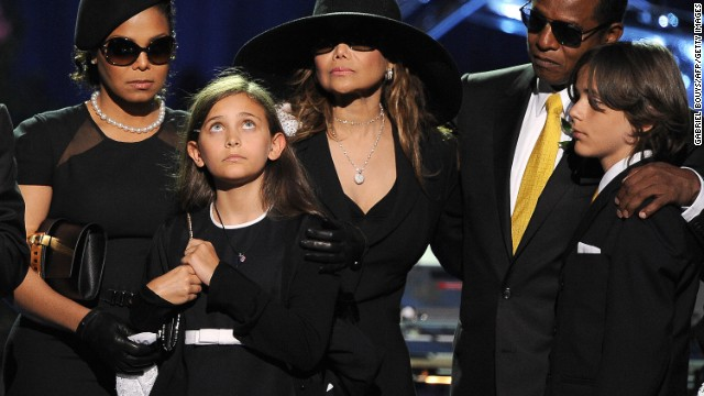 "From left, Michael Jackson's sister Janet Jackson, daughter Paris-Michael Katherine, sister LaToya Jackson, brother Jermaine Jackson and oldest son Prince Michael I attend a memorial service for the ""King of Pop"" at the Staples Center in Los Angeleson July 7, 2009.  AFP PHOTO/GABRIEL BOUYS/POOL (Photo credit should read GABRIEL BOUYS/AFP/Getty Images)"