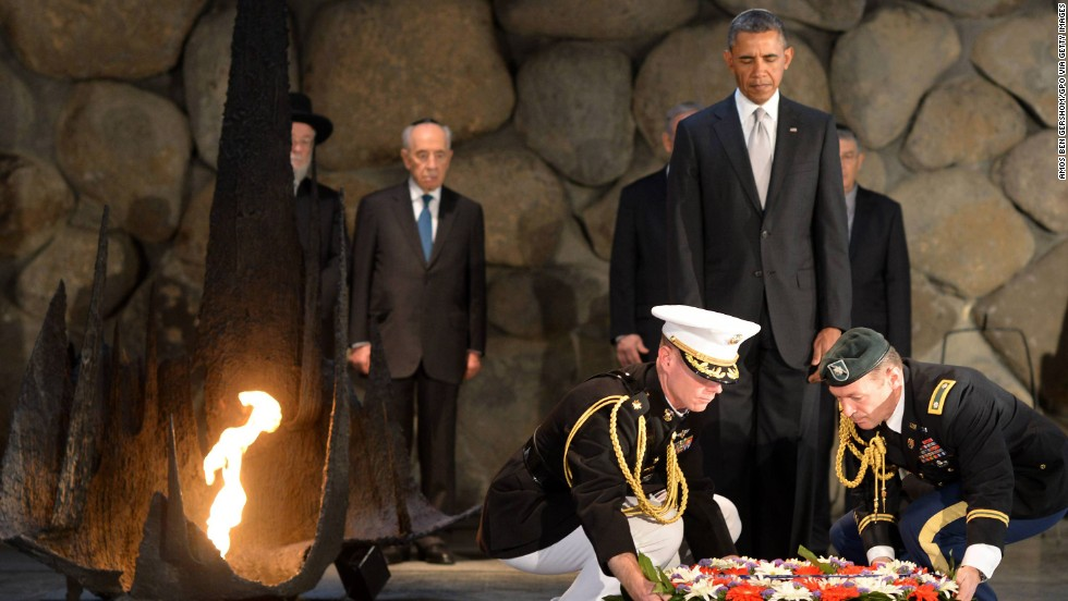 Obama pays his respects in the Hall of Remembrance at Yad Vashem on March 22 as Marines lay a wreath on his behalf.
