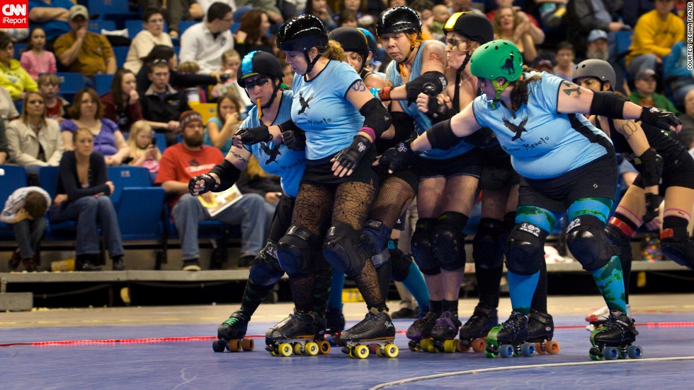 """Frazer, far right, was positioned as a blocker because of her bigger size. Although she was good at using her weight to """"move people,"""" she says she couldn't move very fast herself."""