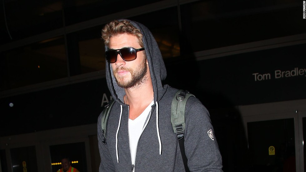 Liam Hemsworth arrives at LAX on March 20.