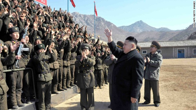 This undated picture released by North Korea's official Korean Central News Agency on March 12, 2013 shows North Korean leader Kim Jong Un (R) inspecting a long-range artillery sub-unit of Korean People's Army Unit 641 at undisclosed place in North Korea.
