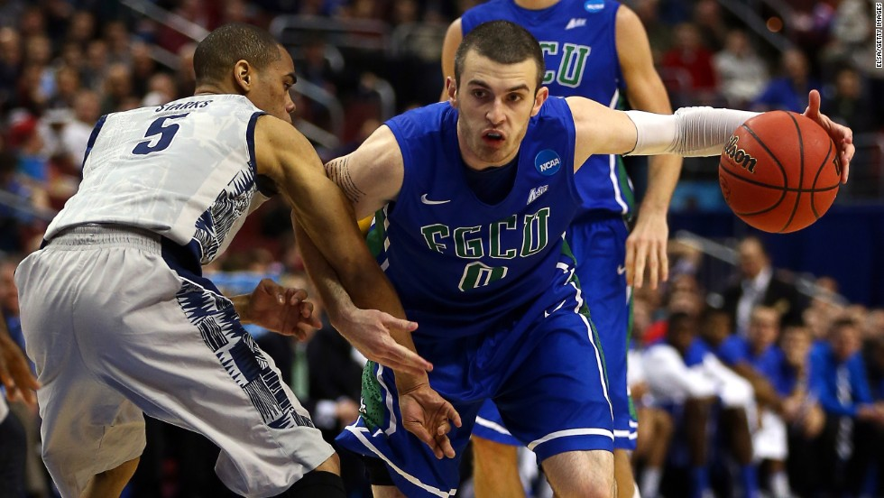 Brett Comer of the Florida Gulf Coast Eagles, right, drives against Markel Starks of the Georgetown Hoyas on March 22.