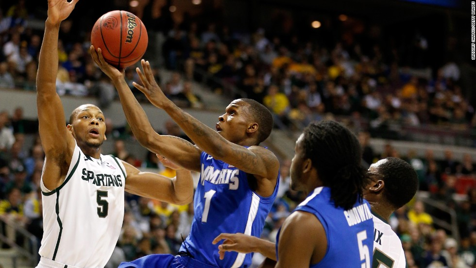 Joe Jackson of Memphis  drives for a shot against Adreian Payne of Michigan State on March 23.