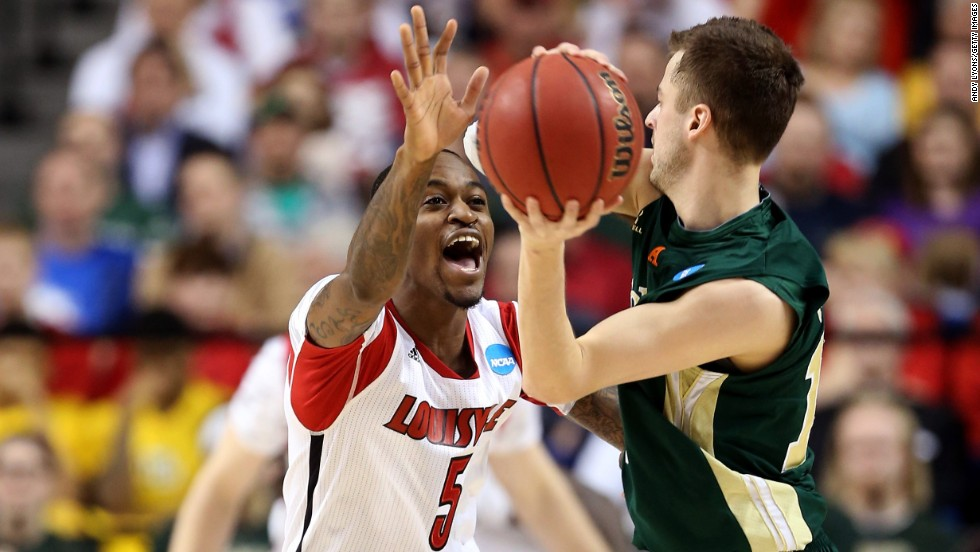 Kevin Ware of Louisville defends against Wes Eikmeier of Colorado State on March 23.