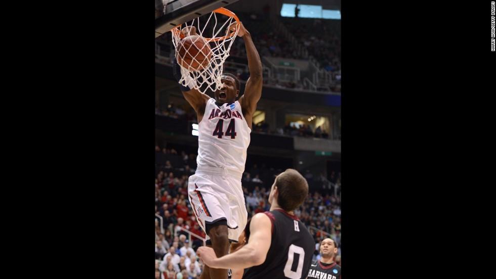 Arizona's Solomon dunks over Harvard's Laurent Rivard on March 23.