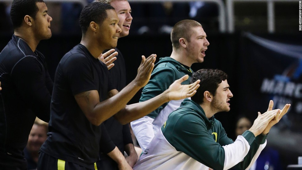 The Oregon bench reacts in the first half against Saint Louis on March 23.