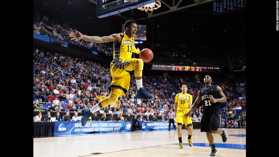 Vander Blue of Marquette, center, reacts after stealing the ball and making a dunk against Butler on March 23.