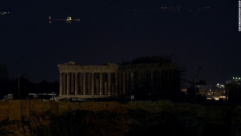 TheTemple of Parthenon atop the Acropolis hill during the Earth Hour in Athens.