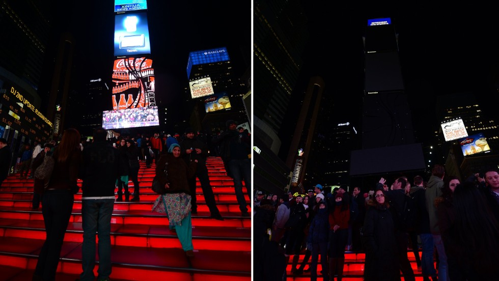 In this combo photo large electronic billboards stand dark on Times Square as their lights were turned off to mark 'Earth Hour' in New York.
