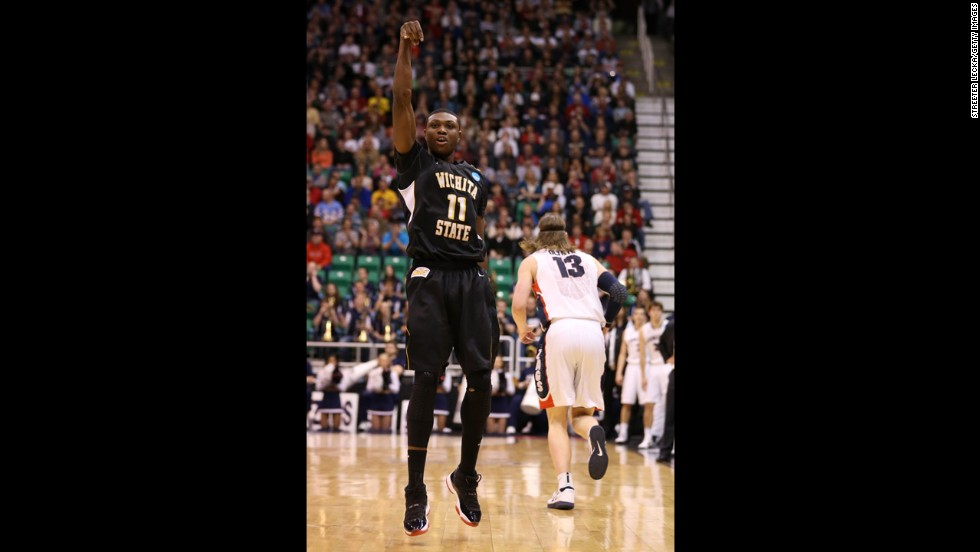 Cleanthony Early of Wichita State, left, celebrates after making a three-pointer against Gonzaga on March 23.