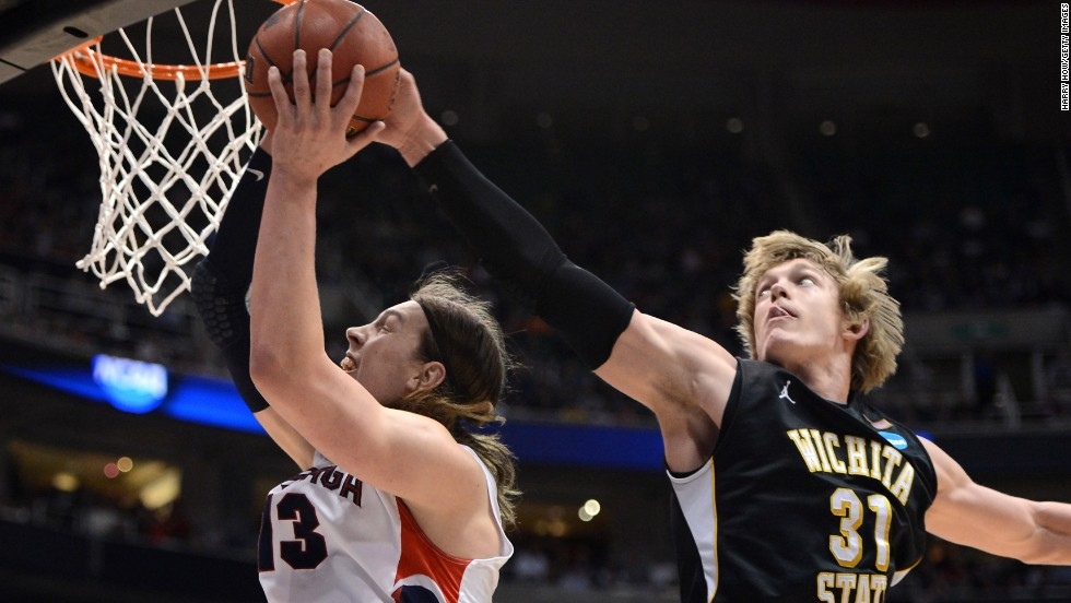 Kelly Olynyk of Gonzaga, left, has his shot blocked by Ron Baker, right, of Wichita State on March 23.