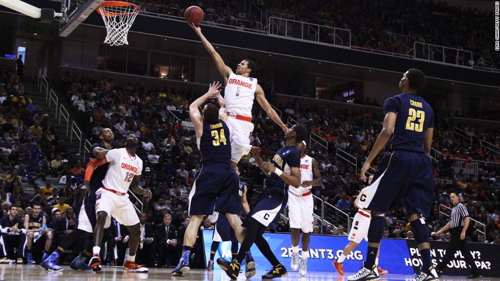 Michael Carter-Williams of the Syracuse Orange, center, goes up over Robert Thurman, left of center, of the California Golden Bears on March 23 in San Jose. Syracuse won 66-60.